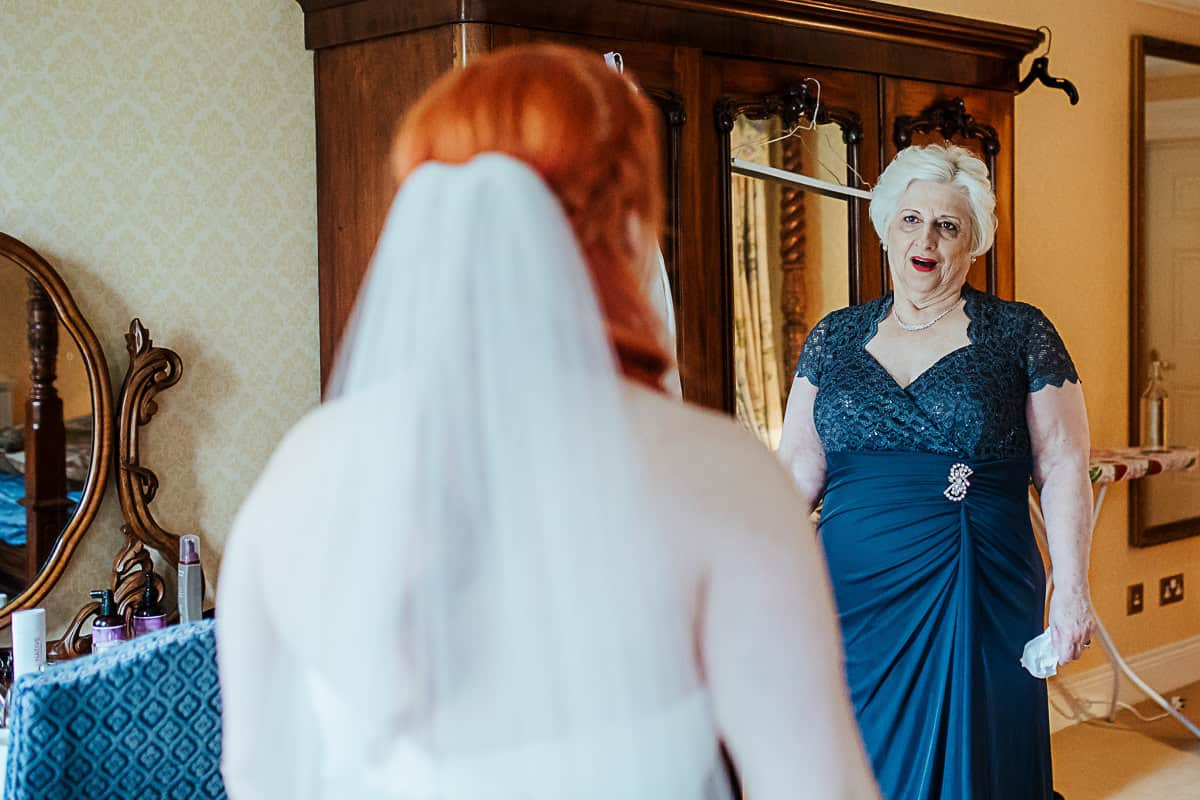 grandmother of the bride seeing her daughter in her wedding dress for the first time