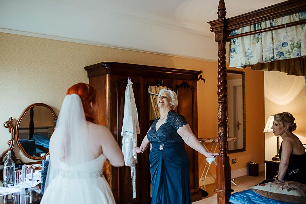 mother of the bride seeing her daughter in her wedding dress for the first time