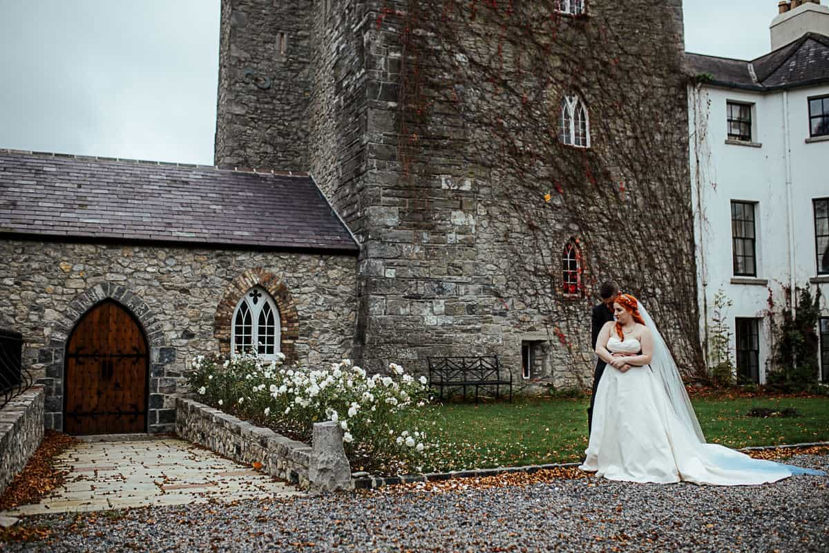 barberstown castle wedding portrait of bride and groom in front of the castle