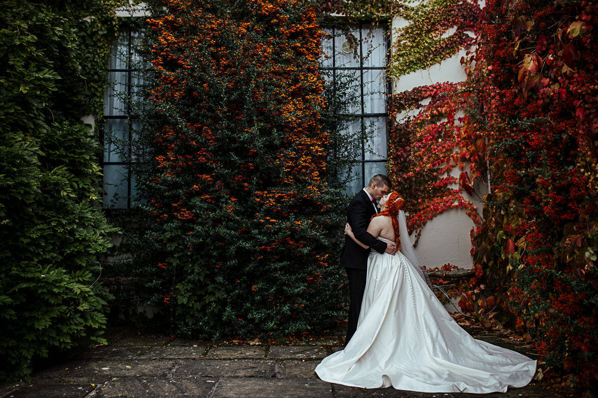 fall destination wedding in ireland colourful leaves wedding photo