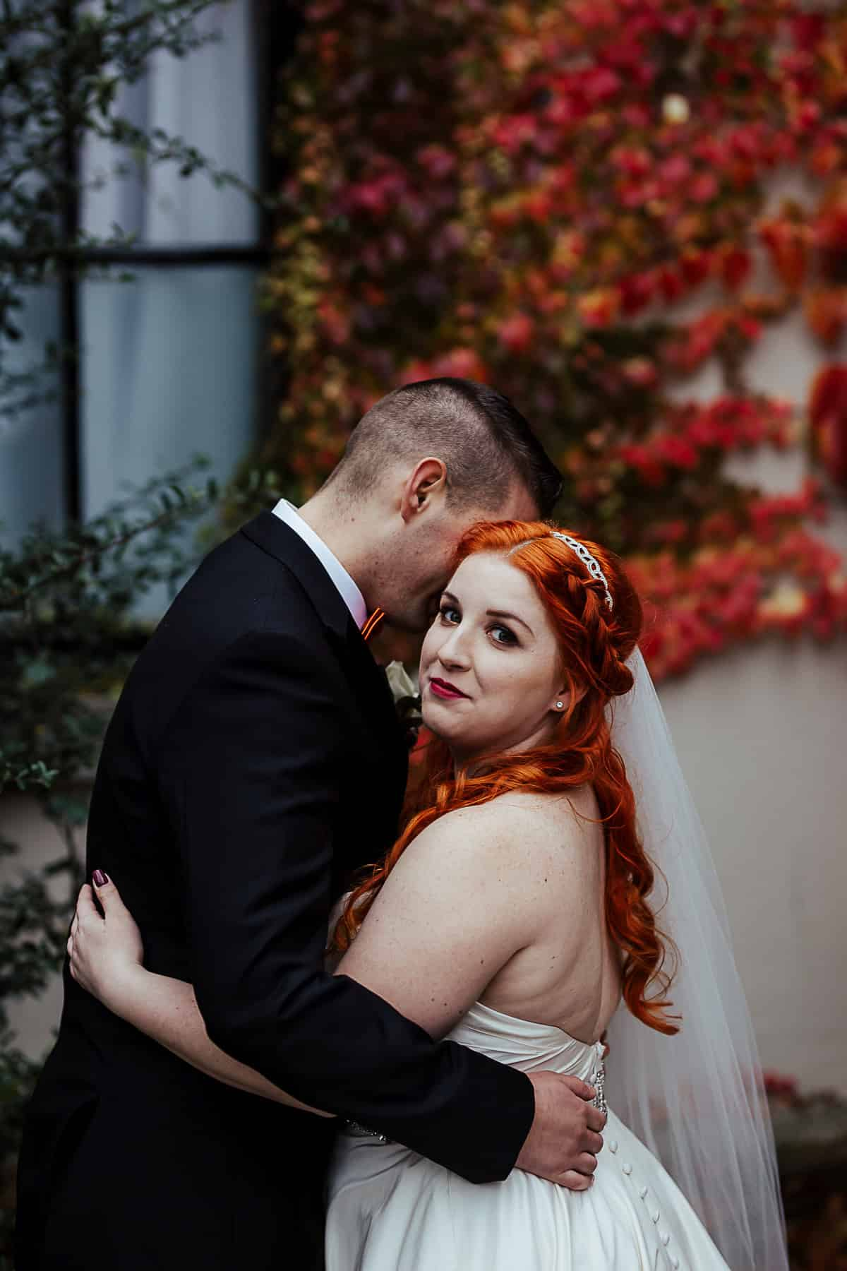 portrait of red head bride against fall colours