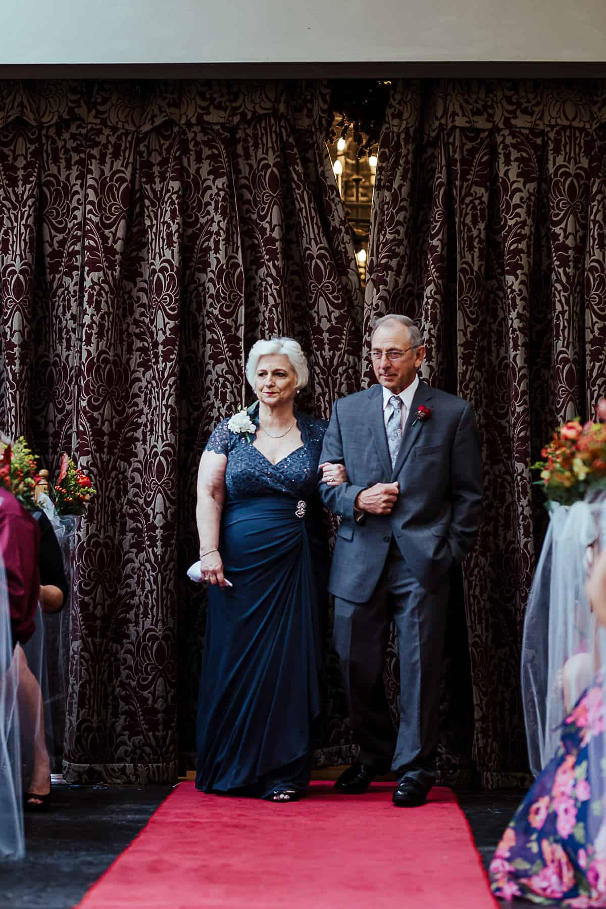 bride's grandparents walking up the aisle