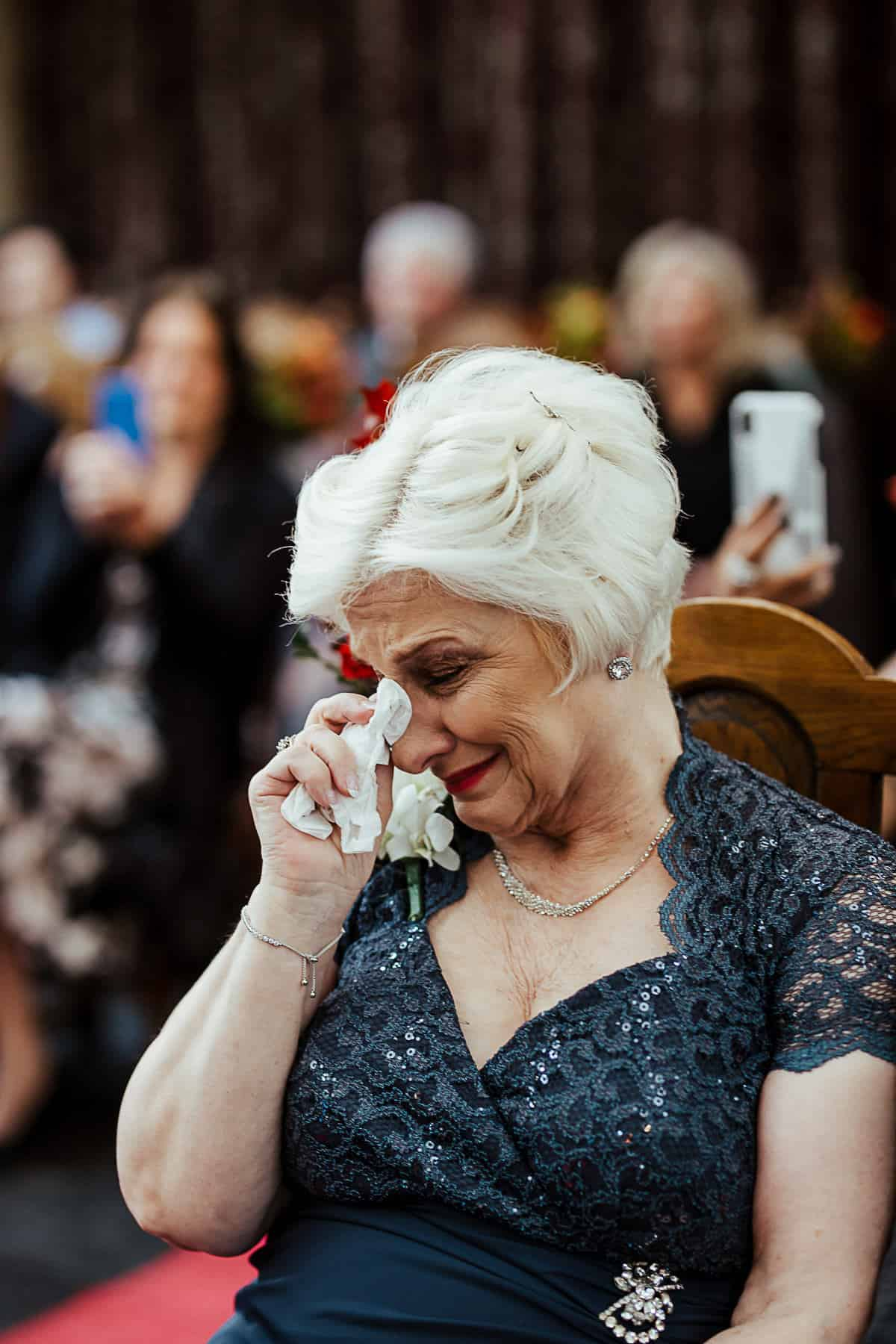 bride's grandmother crying during wedding ceremony