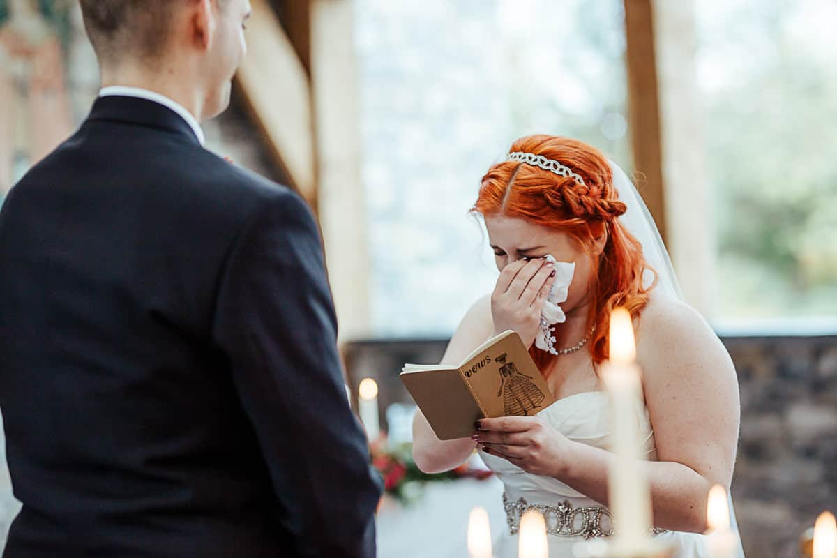 bride crying through her wedding vows
