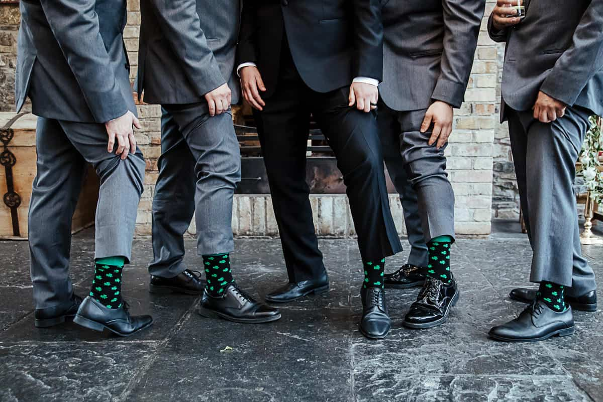groom and groomsmen wearing matching shamrock socks destination wedding in ireland