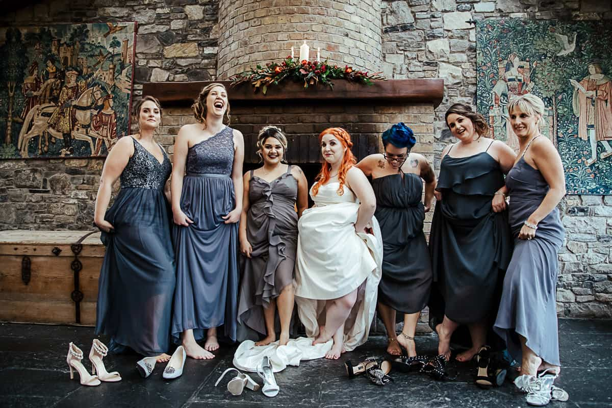 bride and bridesmaids kicking off their shoes