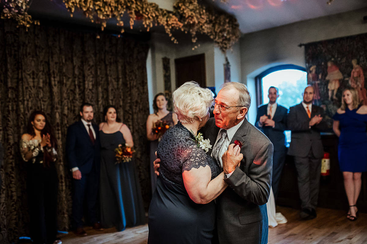 older couple dancing to their first dance song at 50th wedding anniversary