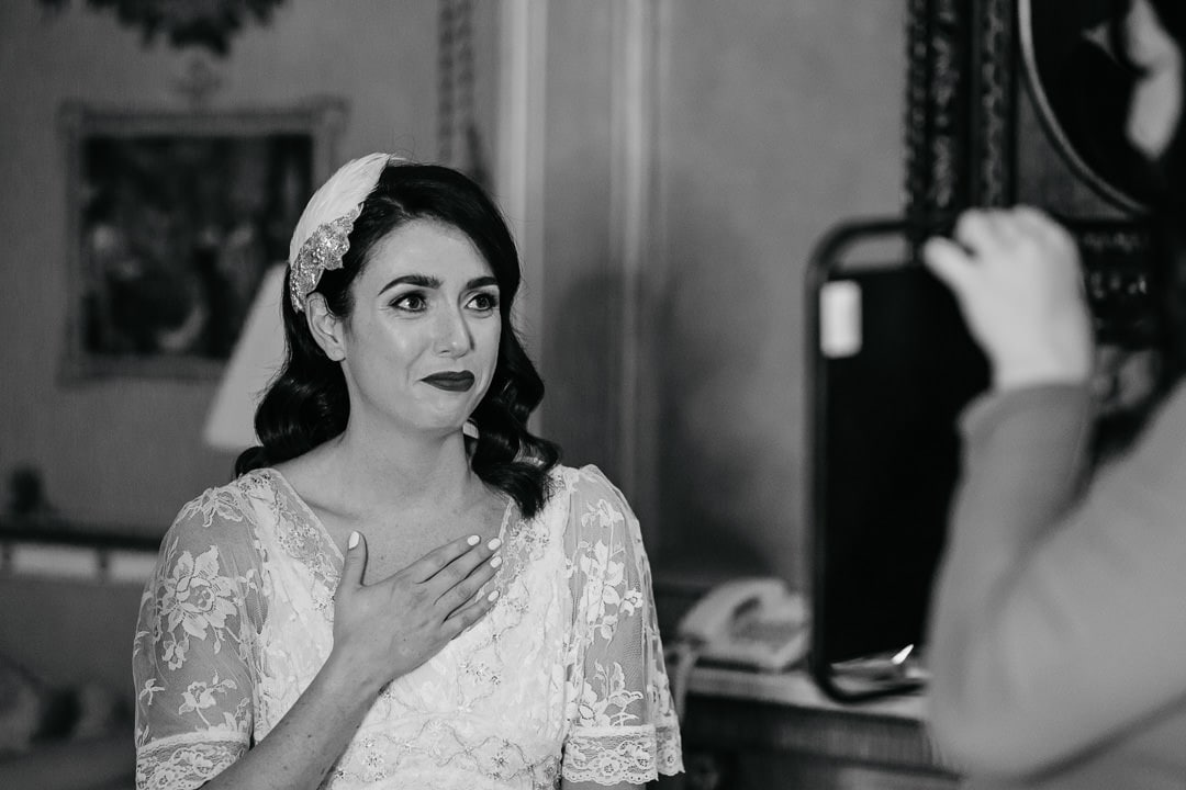 emotional bride seeing herself in the mirror for the first time