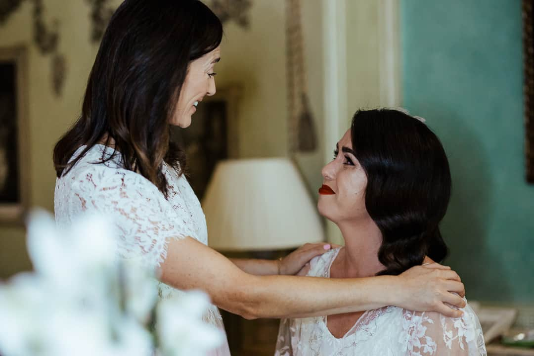 bride and her sister as maid of honour having an emotional moment