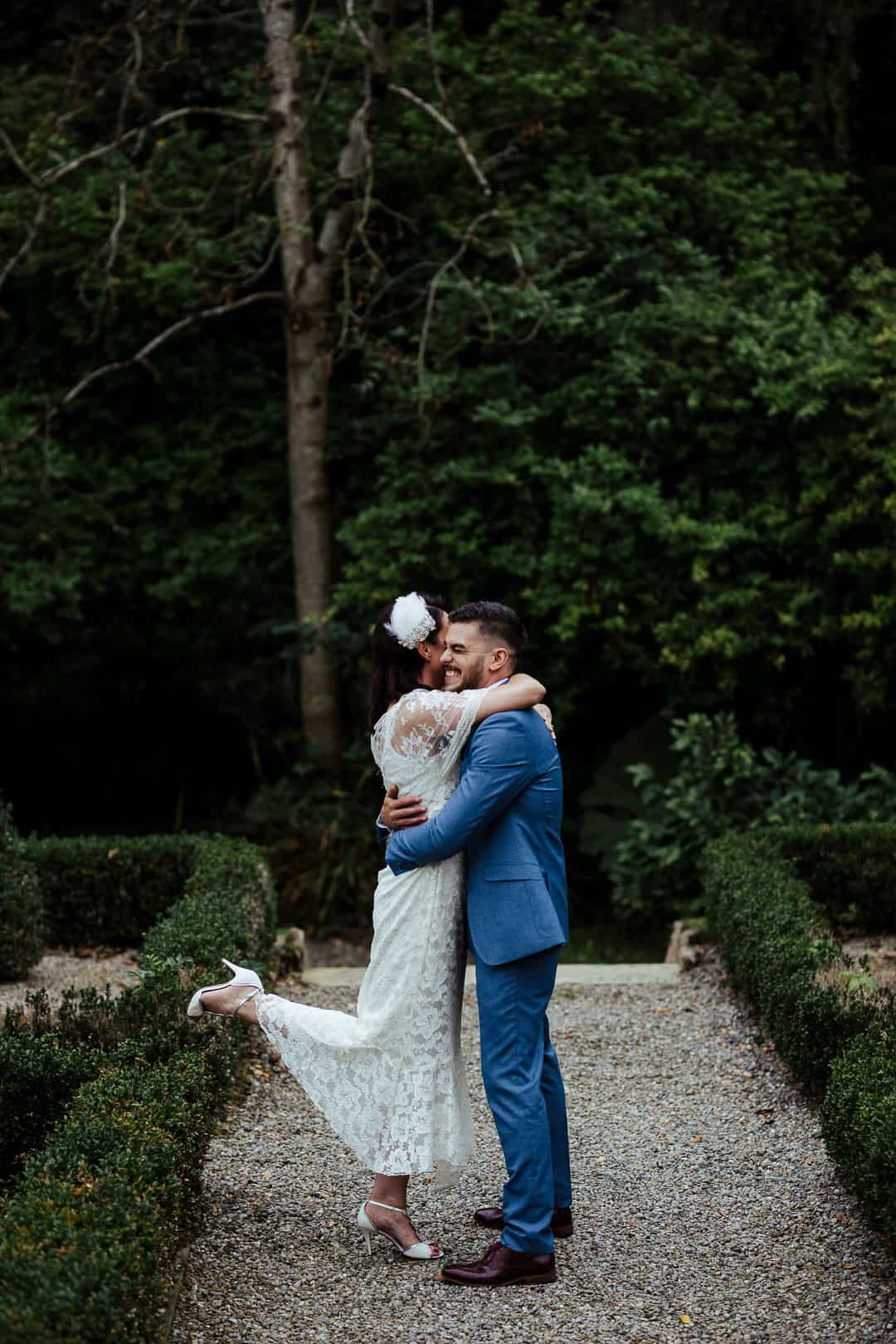 bride and groom hugging in marlfield house gardens candid wedding photographer ireland