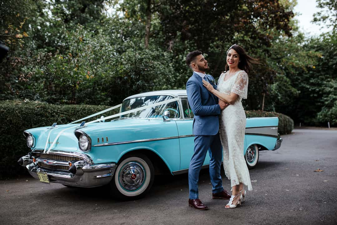 bride and groom in front of american vintage wedding car blue chevy ireland