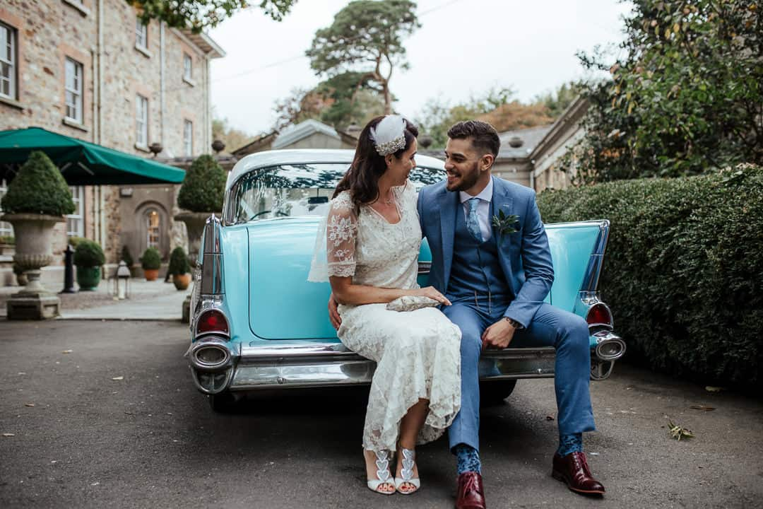 bride and groom sitting on the back of american vintage wedding car blue chevy ireland