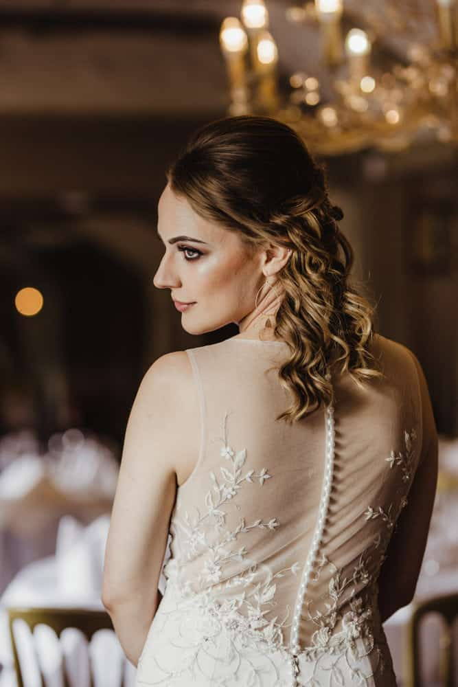 elegant wedding gown with transparent back and buttons