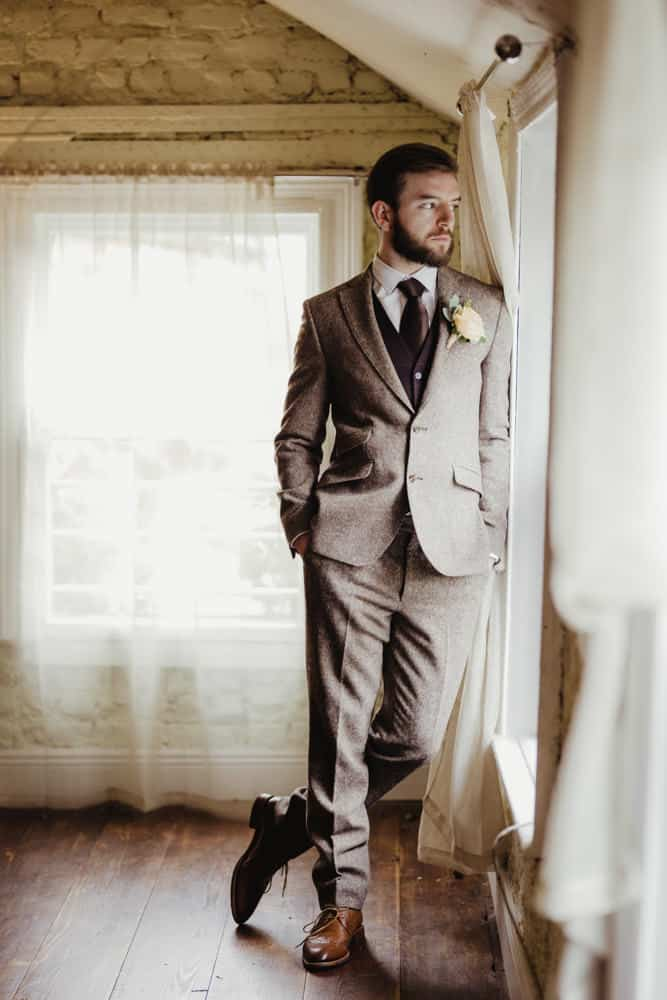 groom in a tweed brown suit