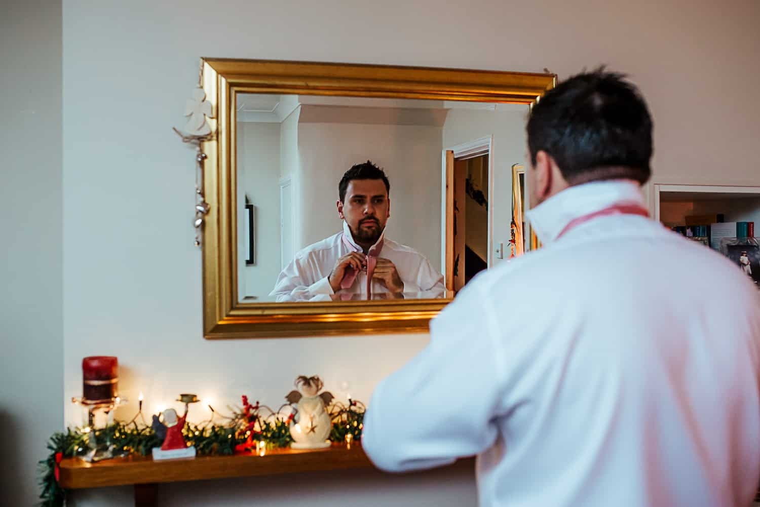 groom putting on his tie documentary wedding photographer dublin