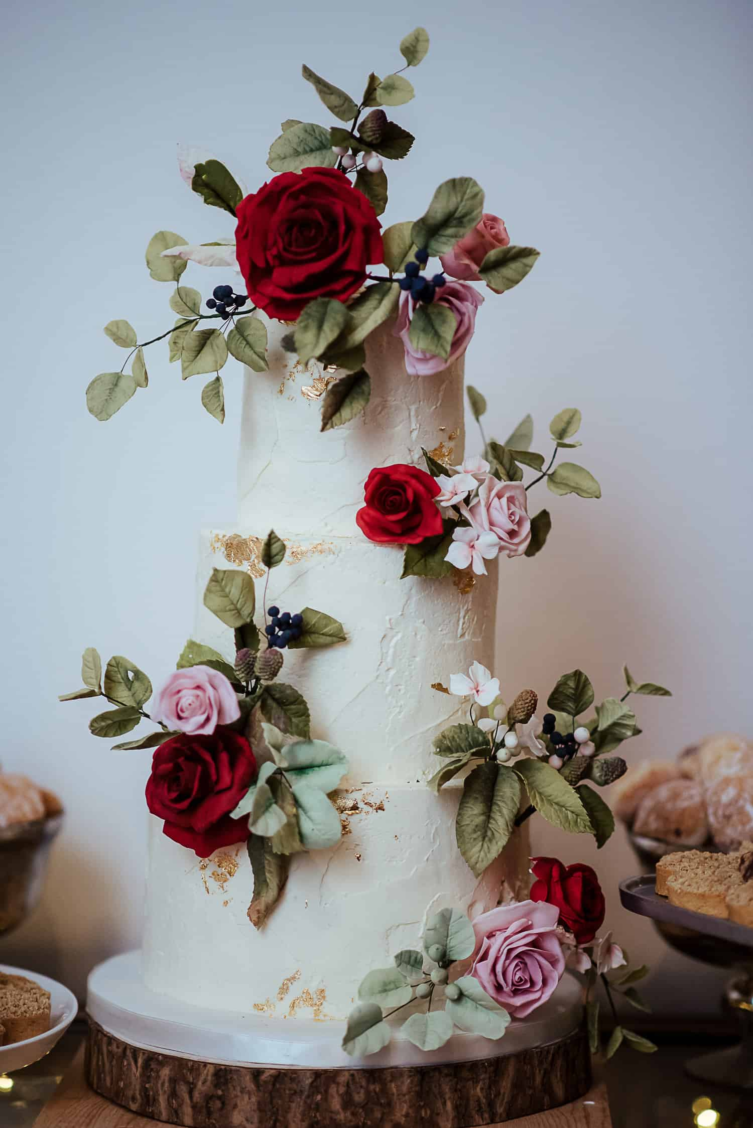 cupcakes and counting white wedding cake with sugar roses