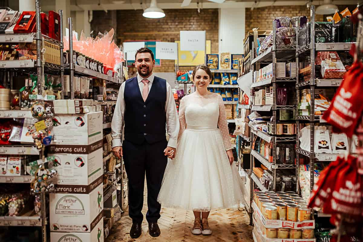 wes anderson inspired wedding photo in fallon and byrne supermarket