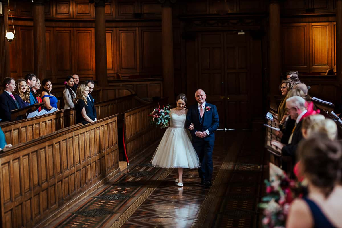 trinity college wedding dublin bride and her father walking up the aisle