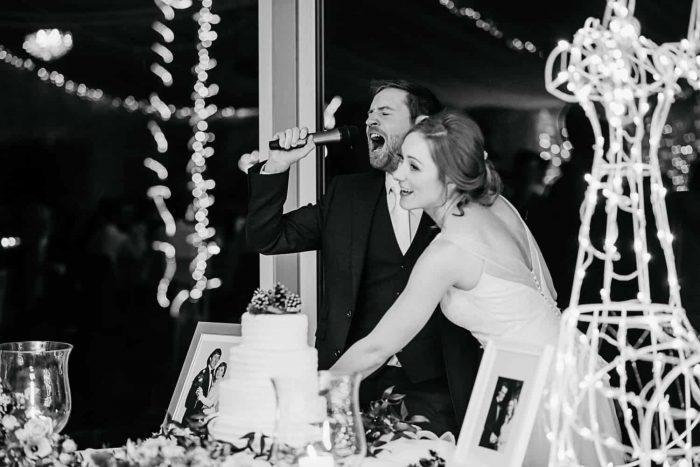 funny photo of weddubg couple cutting the cake