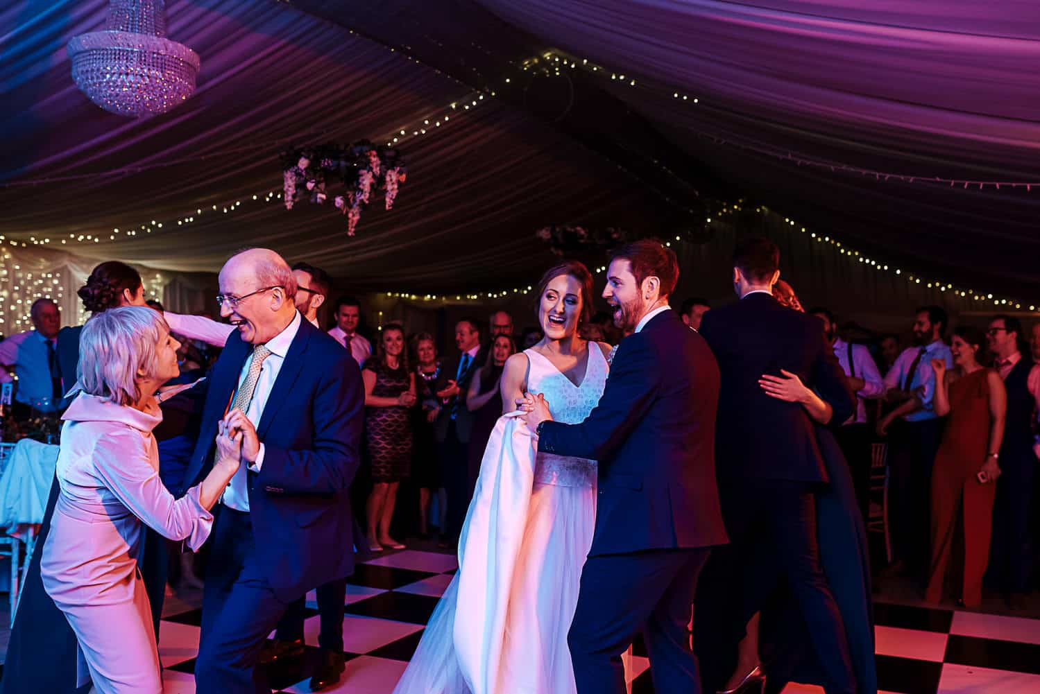 bride and groom dancing with their parents ashley park house wedding