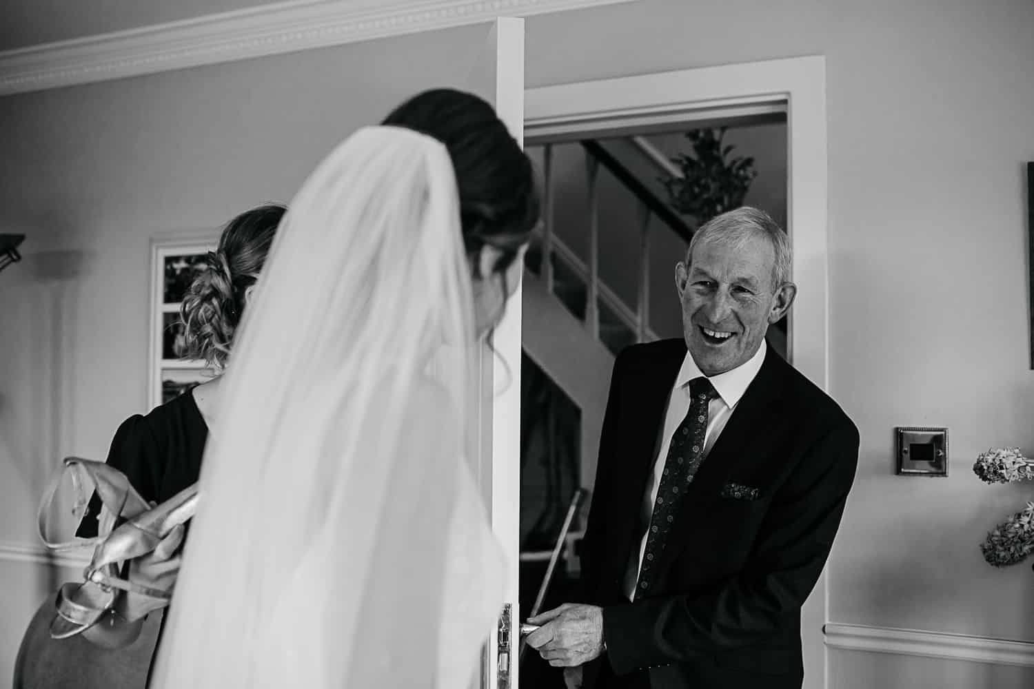 father seeing his daughter for the first time on her wedding day documentary wedding photographer