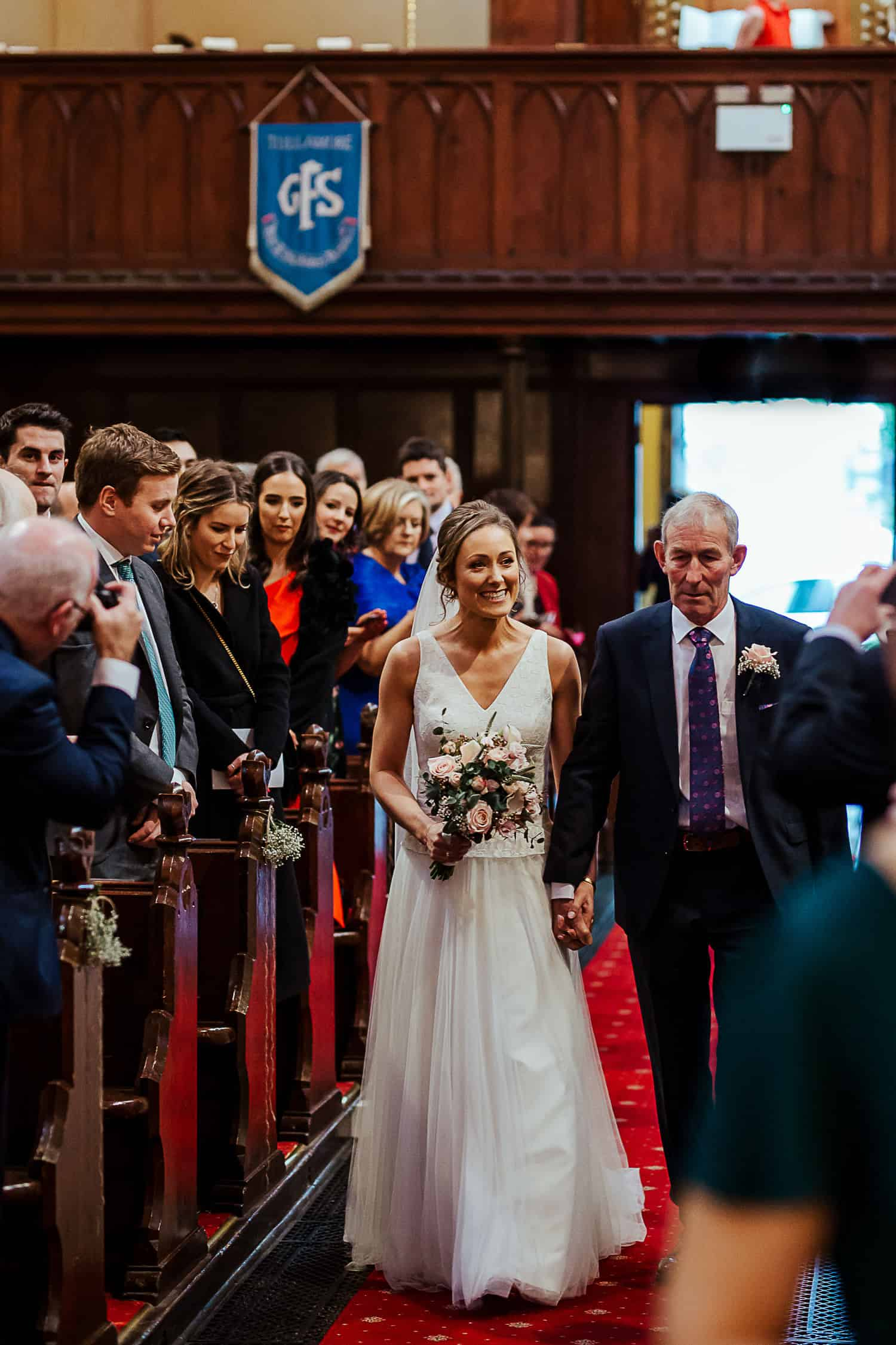 bride and her father walking up the aisle wedding photographer ireland