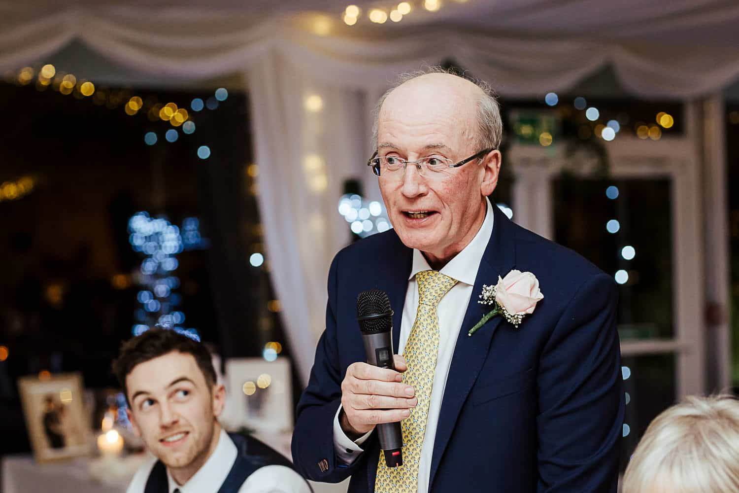 father of the groom giving a wedding speech
