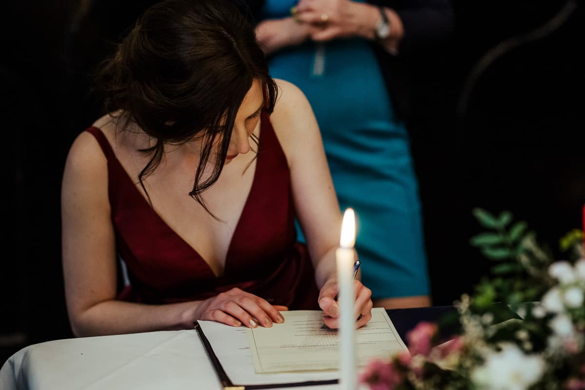 bride signing the register kinnity castle wedding