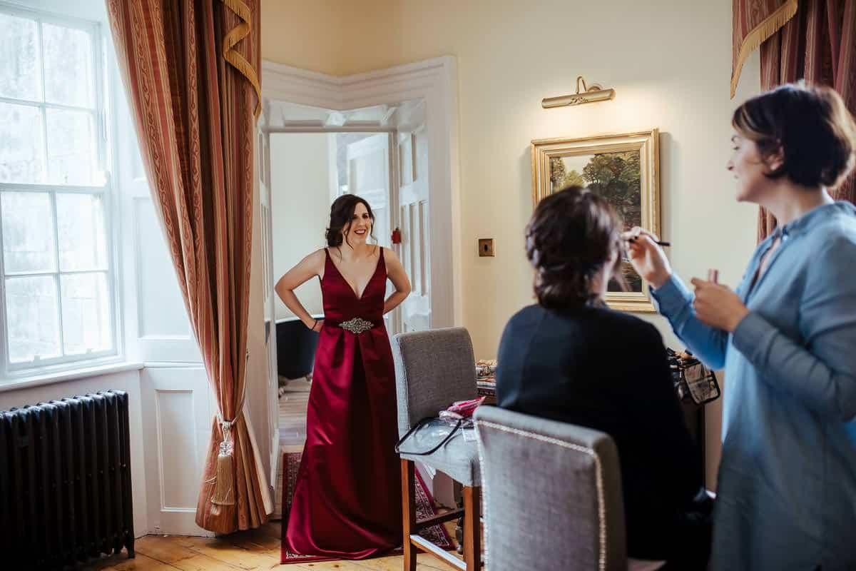 kinnity castle wedding bride in coloured burgundy wedding dress