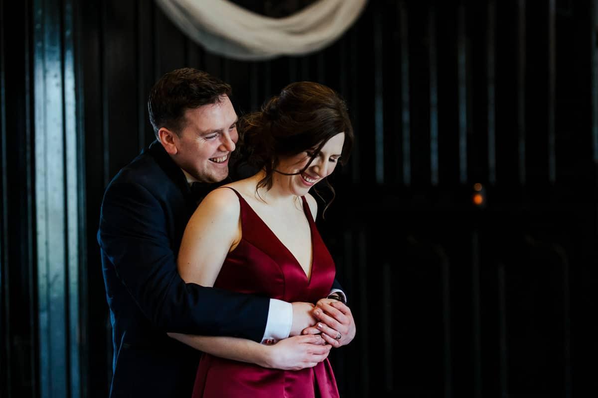 groom and bride in burgundy dress
