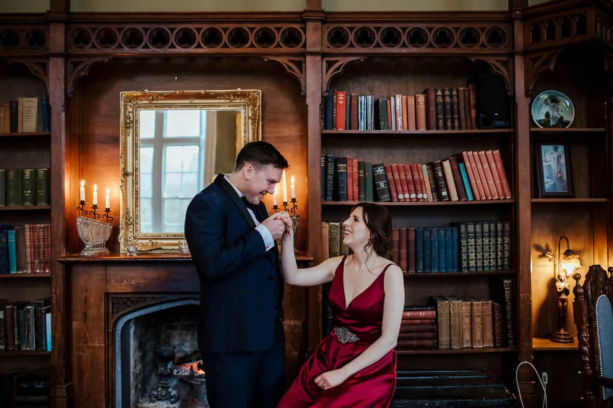 kinnity castle wedding portrait of bride and groom in library bar