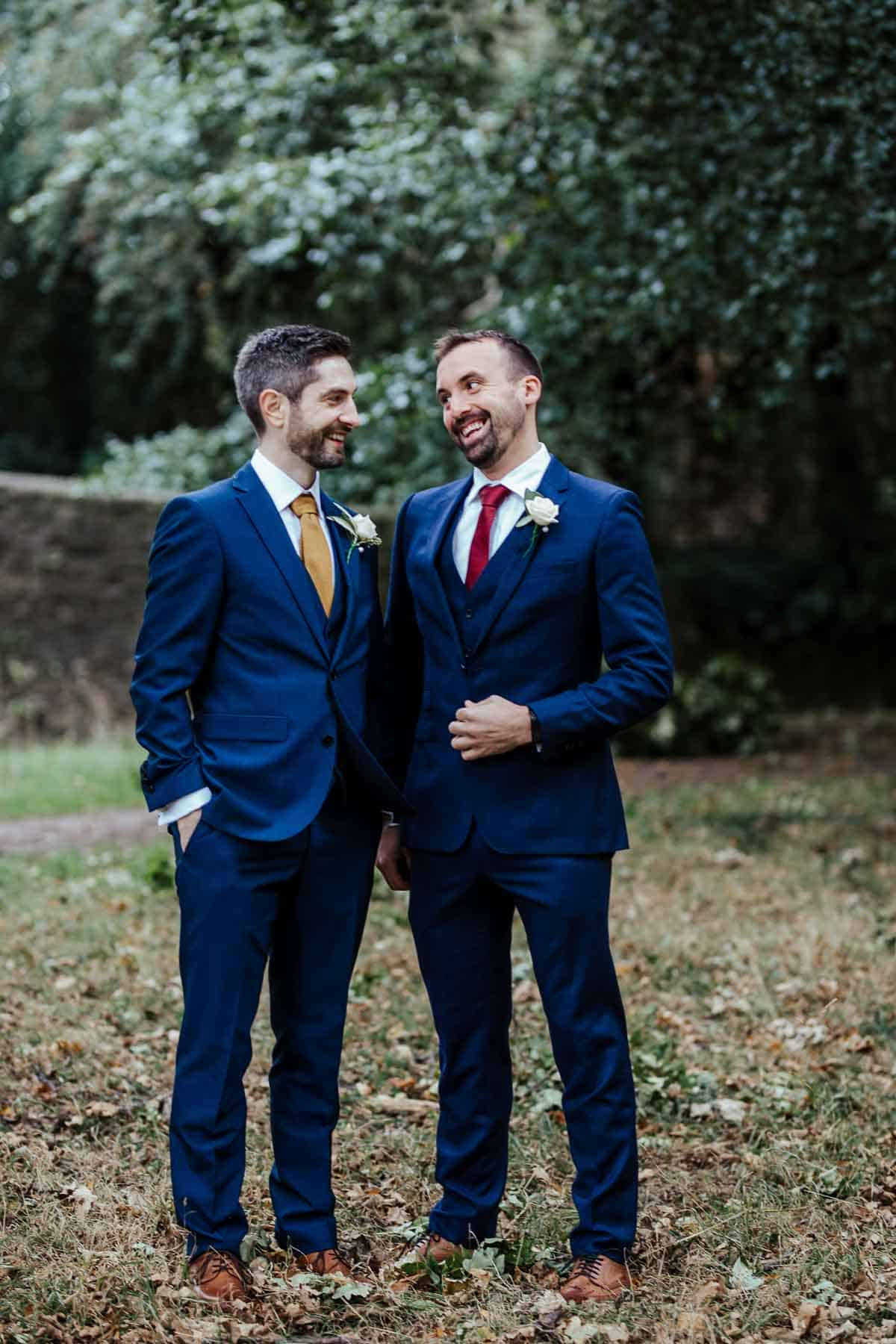 groom and best man portrait in phoenix park autumn wedding in wrights anglers rest