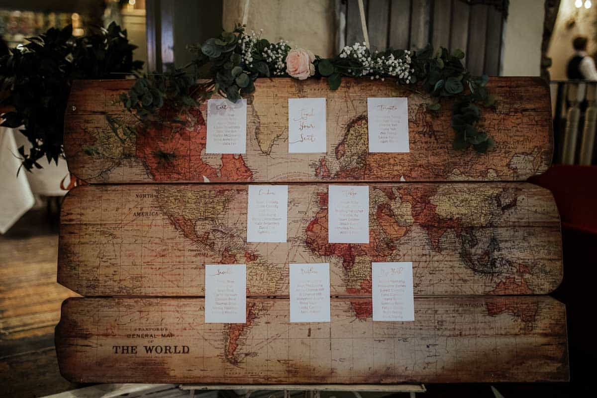 travel theme wedding decortable seating plan on world map wrights anglers rest wedding dublin