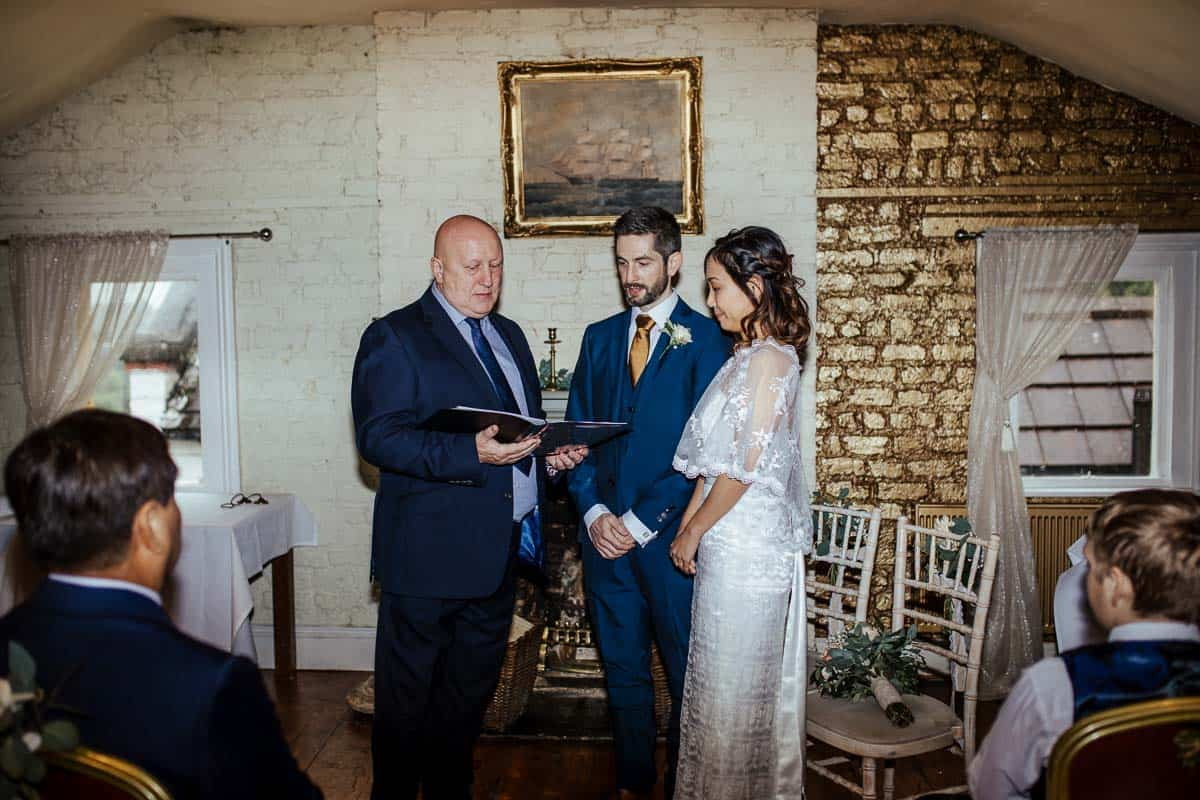 bride and groom exchange vows at wights anglers rest wedding dublin