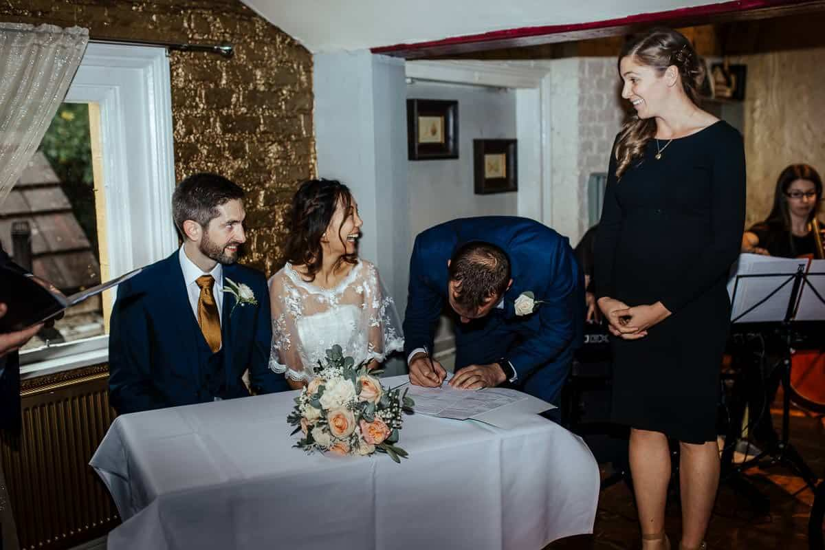 signing of the register wrights anglers rest wedding ceremony