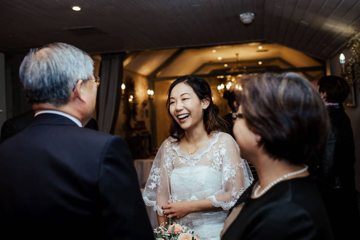 guests laughing at wrights anglers rest wedding documentary wedding photographer dublin