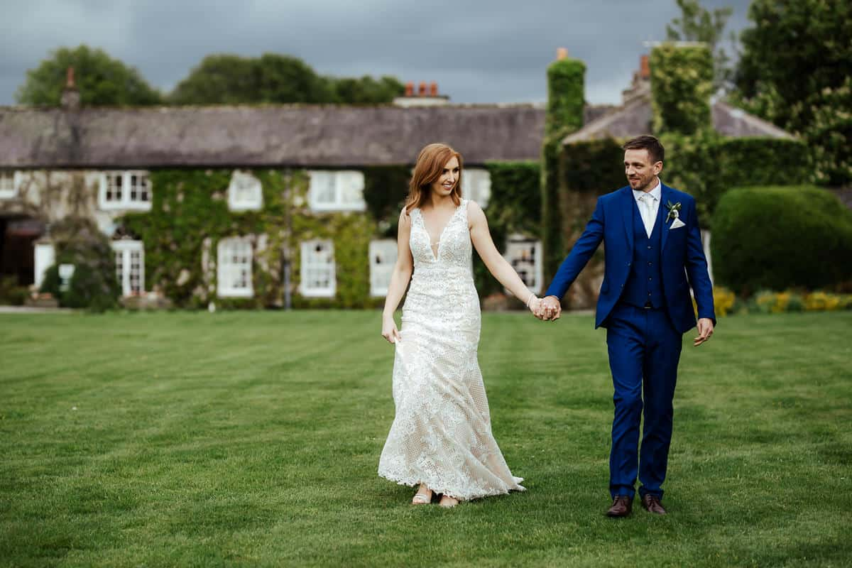 bride and goom on the lawn of rathsallagh house