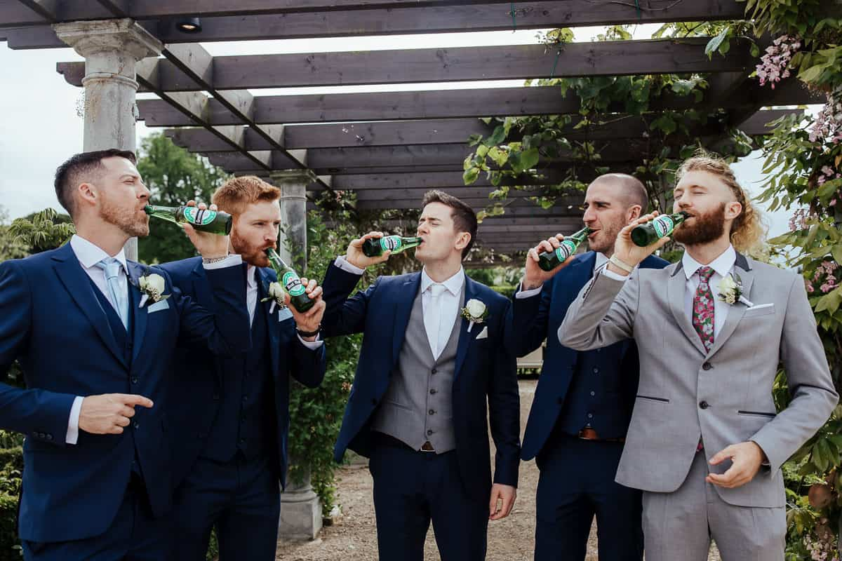 groomsmen with personalized beer bottles gromsmen gift ideas