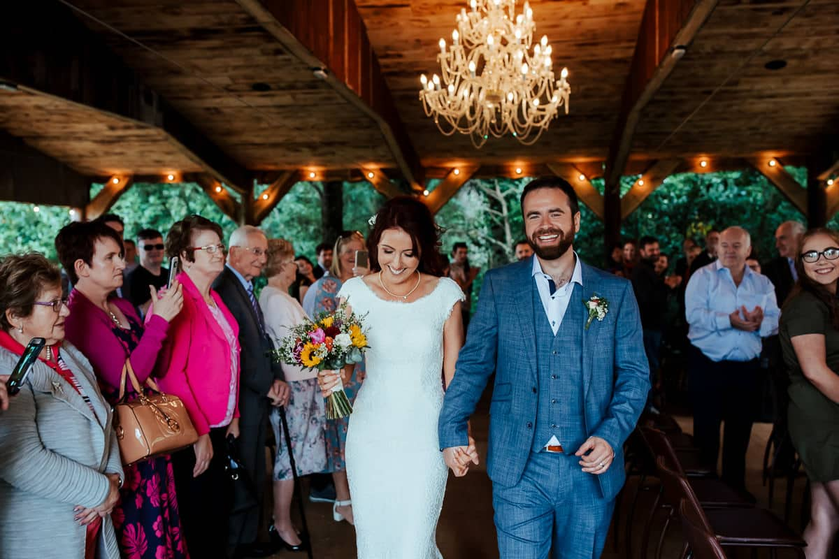 outdoor wedding ceremony in the woodlands at martinstown house