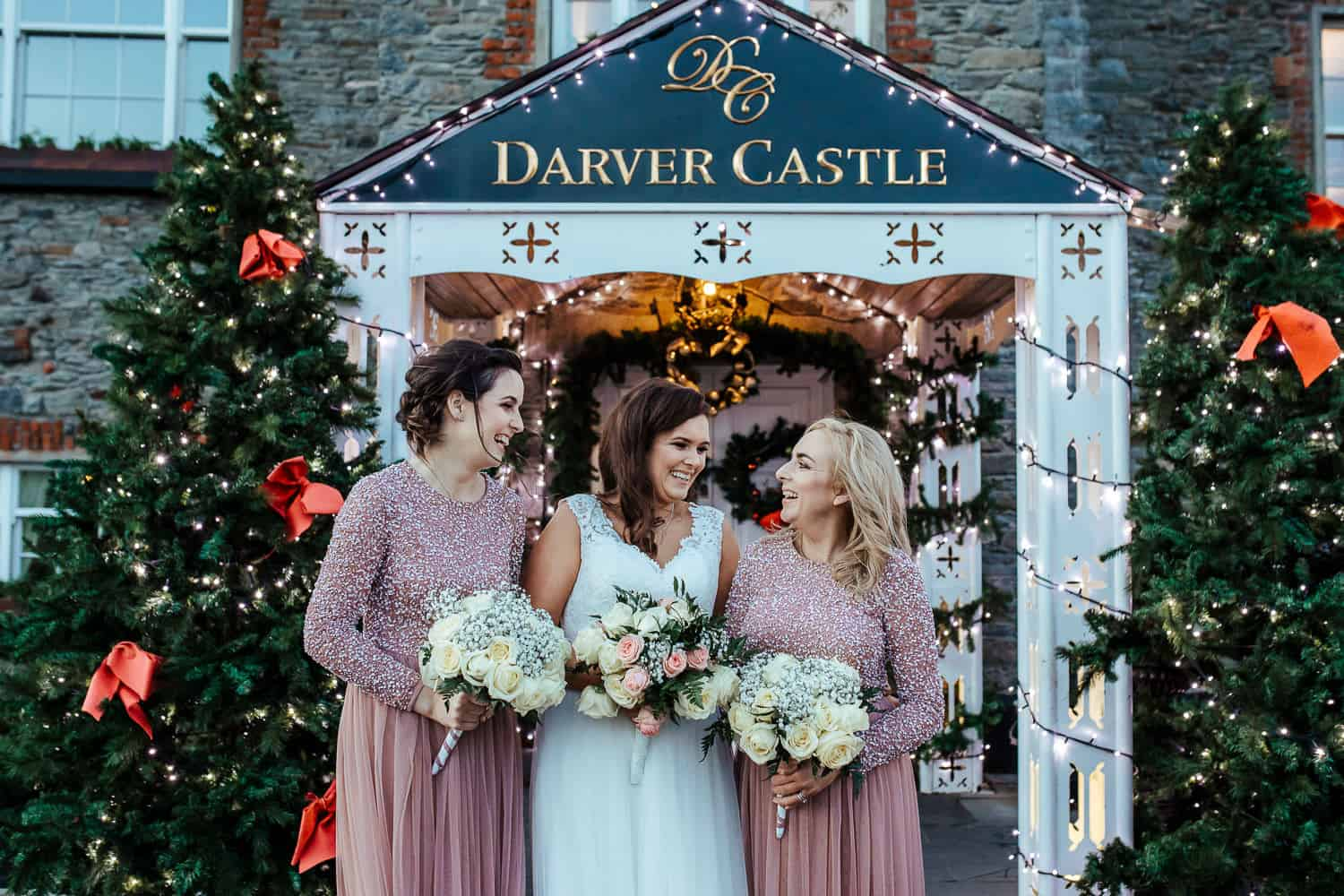 bride and bridesmaids in pink sequin at darver castle winter wedding