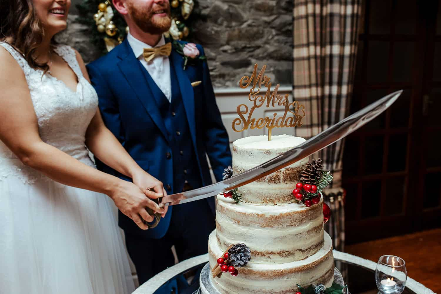 cake cutting with a real sword at darver castle wedding