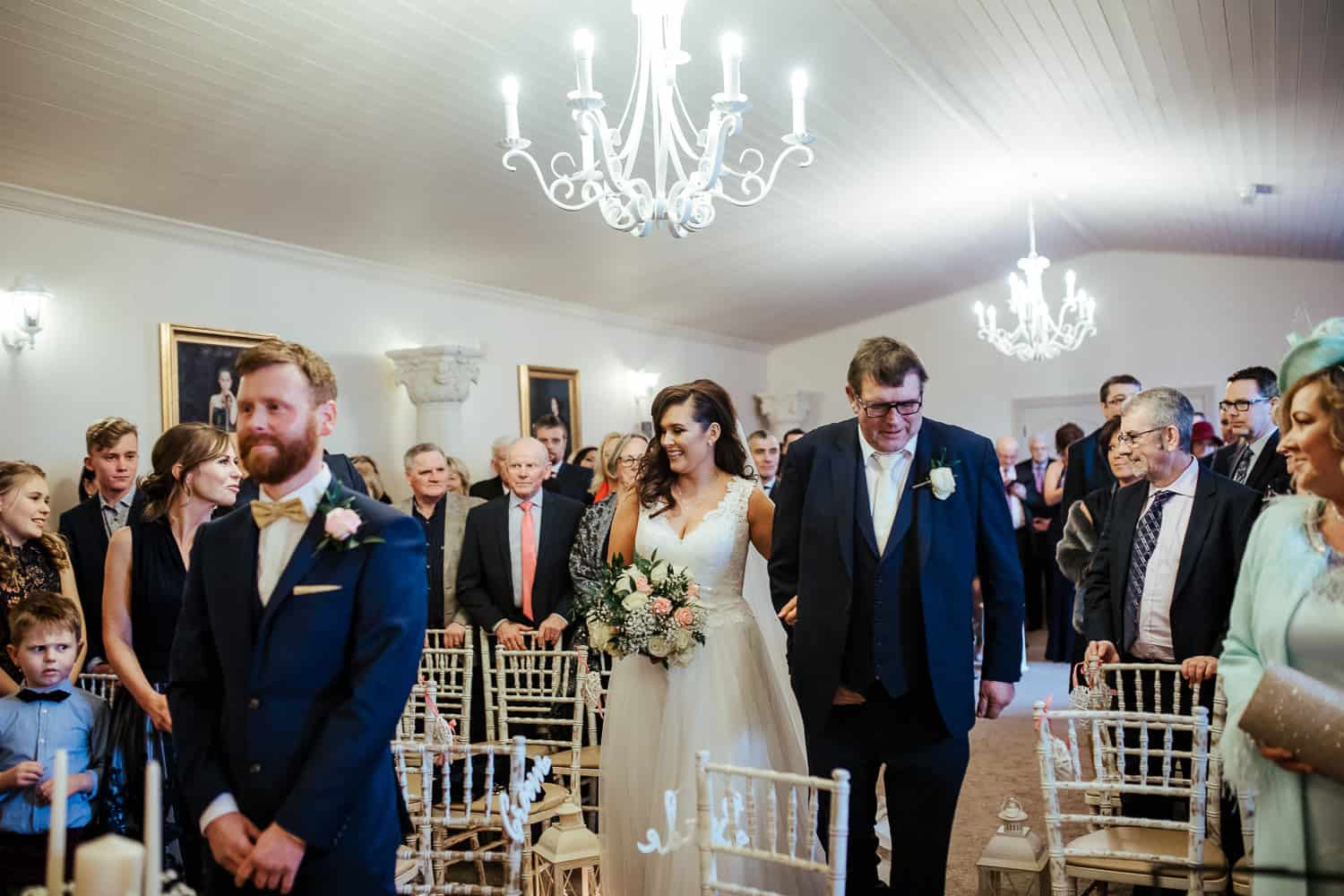 bride and her father walking up the aisle at darver castle civil wedding ceremony