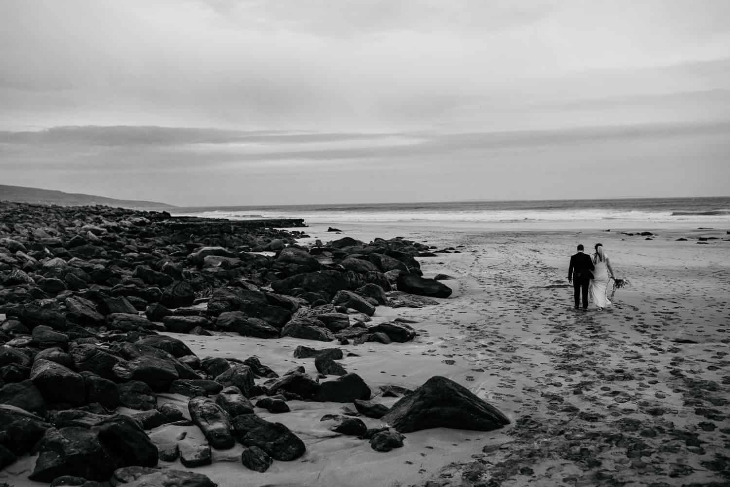 wedding couple at wild beach in clare ireland
