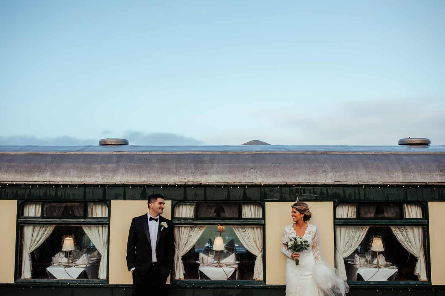 bride and groom at pullman train glenlo abbey wedding
