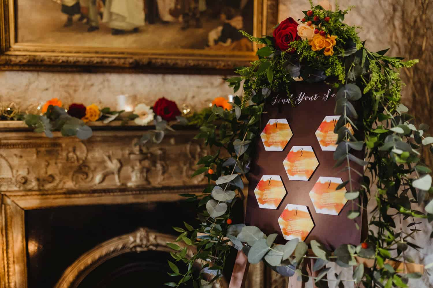 wedding table seating plan decorated with flowers