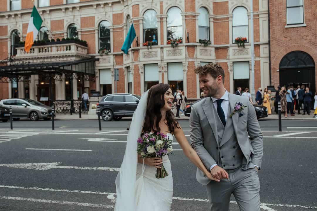 the shelbourne hotel wedding photo couple walking in dublin city centre